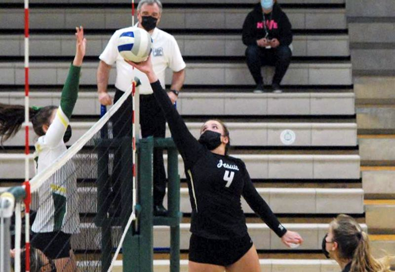 COURTESY PHOTO: OSAATODAY - This set from Alison Buchholz in the third set helped break open a tie game on the way to Jesuit's sweep of West Linn at West Linn High School on Wednesday, Apil 7.