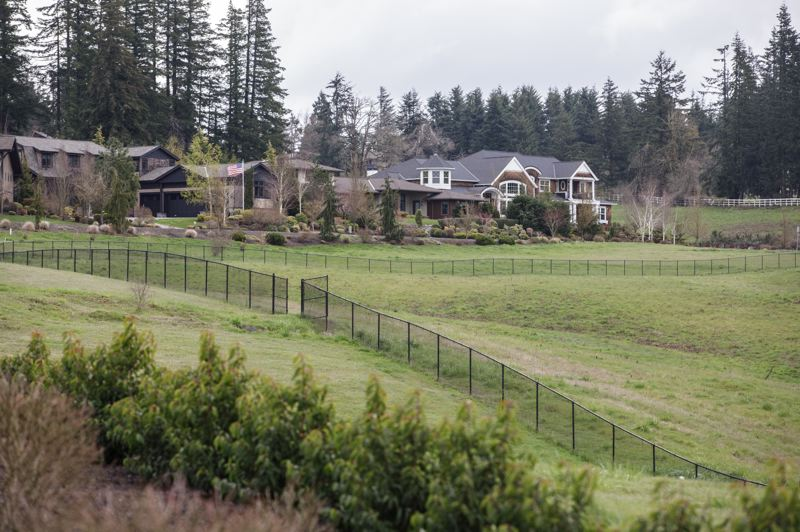 PMG PHOTO: JONATHAN HOUSE - A fence separates the property owned by Charlie Hoff and already-developed property in Stafford.