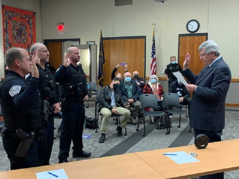 COURTESY PHOTO - From left, Todd Trap, Jorge Tro and Doug Kitzmiller take their oaths of office during the Wednesday, April 7, Canby City Council meeting.