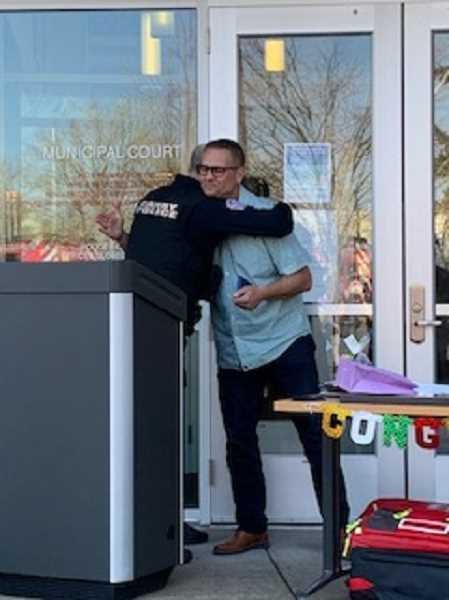 COURTESY PHOTO - Jorge Tro offers Chief Bret Smith a farewell hug at Smith's retirement April 1.