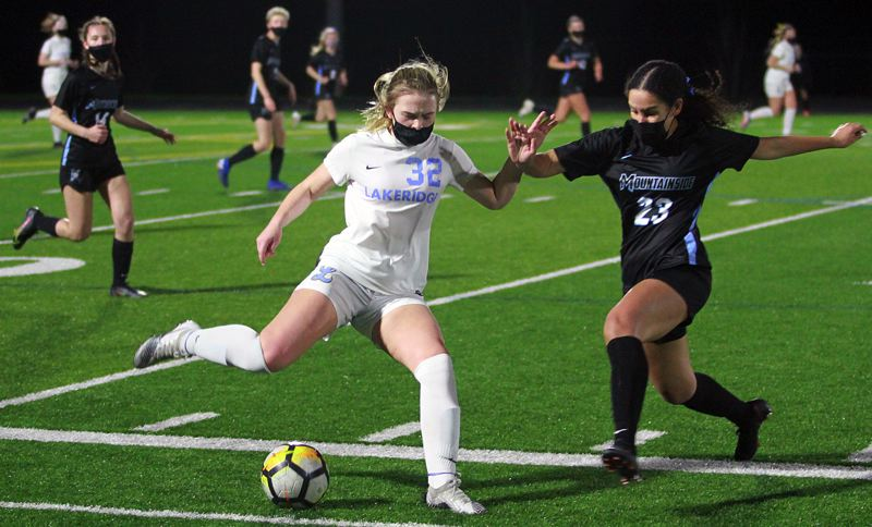 PMG PHOTO: MILES VANCE - Lakeridge's Tessa French (left) and Mountainside's Hana Sawan battle for control of the ball during the Mavericks' 1-0 win at Mountainside High School on Thursday, April 8.