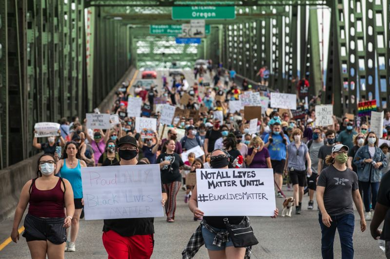 FILE - Protesters marched toward Oregon on the Interstate Bridge to celebrate Juneteenth on Friday, June 19, 2020.