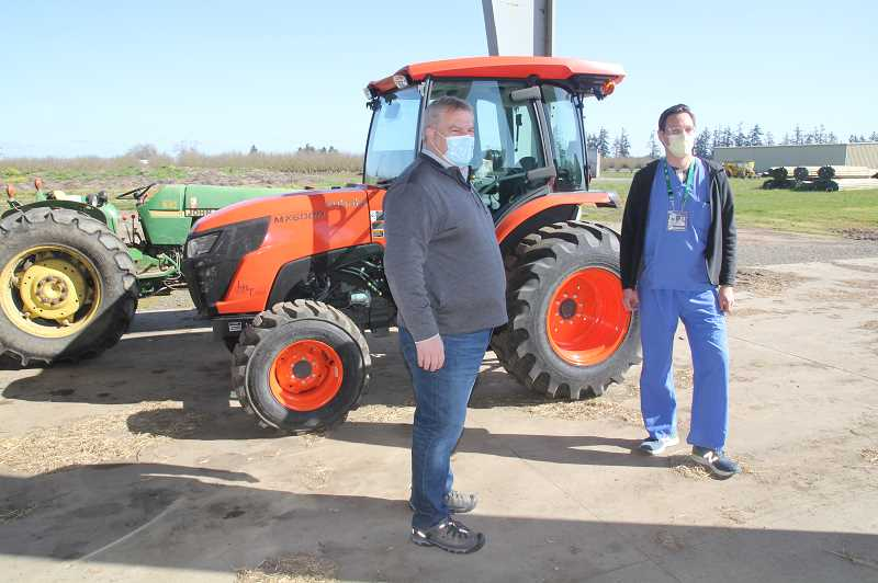 PMG PHOTO: JUSTIN MUCH - Coleman Agriculture President David Henze, left, and Legacy Health Vice President of Population Health Nick Kashey chat prior to conducting a pop-up mobile vaccination clinic at the St. Paul area farm.