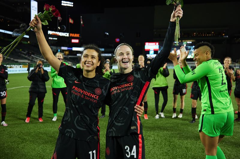 COURTESY PHOTO: CRAIG MITCHELLDYER/PORTLAND THORNS FC - Goal scorers Rocky Rodrigues (11) and Tyler Lussi (34) acknowledge fans as Adrianna Franch and teammates celebrate around them on Friday, April 9 after the Portland Thorns' 2-1 win over Kansas City at Providence Park.