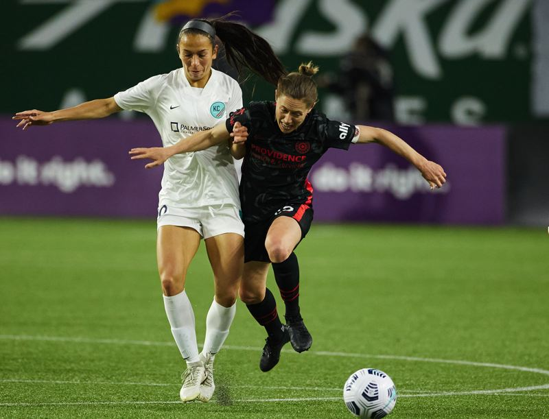 COURTESY PHOTO: CRAIG MITCHELLDYER/PORTLAND THORNS FC - Thorns midfielder Meghan Klingenberg fights off a tackle attempt during Portland's 2-1 win Friday at Providence Park.