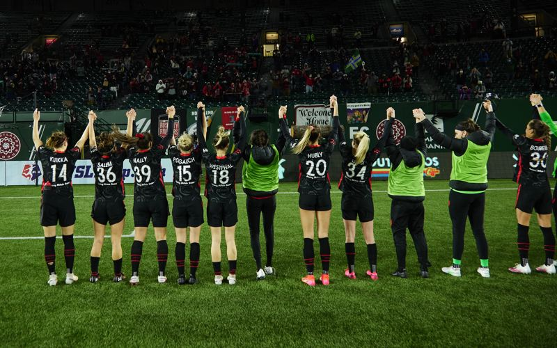 COURTESY PHOTO: CRAIG MITCHELLDYER/PORTLAND THORNS FC - The Portland Thorns salute the fans Friday, April 9 after their 2-1 win over Kansas City, the first time since 2019 that fans have been allowed at a soccer match at the downtown stadium.