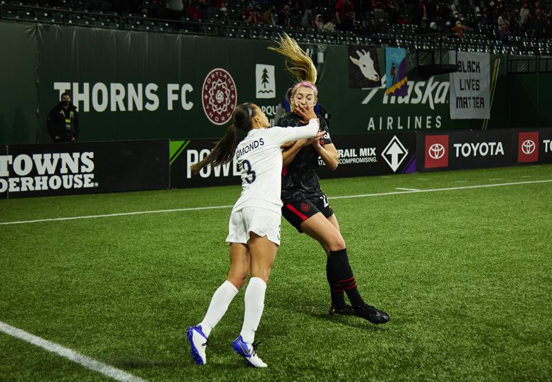 COURTESY PHOTO: CRAIG MITCHELLDYER/PORTLAND THORNS FC - It wasn't all kumbaya at Providence Park Friday. Late in the match Kansas City forward Kristen Edmonds popped Portland's Morgan Weaver in the face as the two players scuffled following a battle for possession. Both players received red cards as part of a wild conclusion to the match