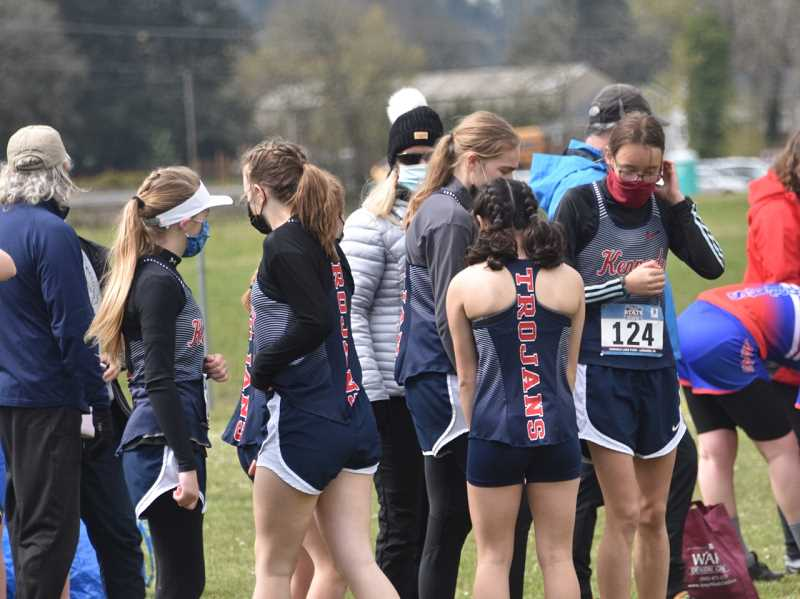 COURTESY PHOTO: JEREMY MCDONALD/JMCONDALDMEDIA - The Kennedy girls cross country team prepares for the start of the 3A/2A/1A state championship meet held Saturday at Cheadle Lake Park in Lebanon.