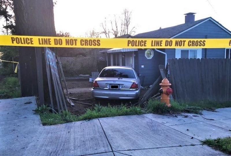 COURTESY PHOTO - The car crashed through a fence after being stolen.