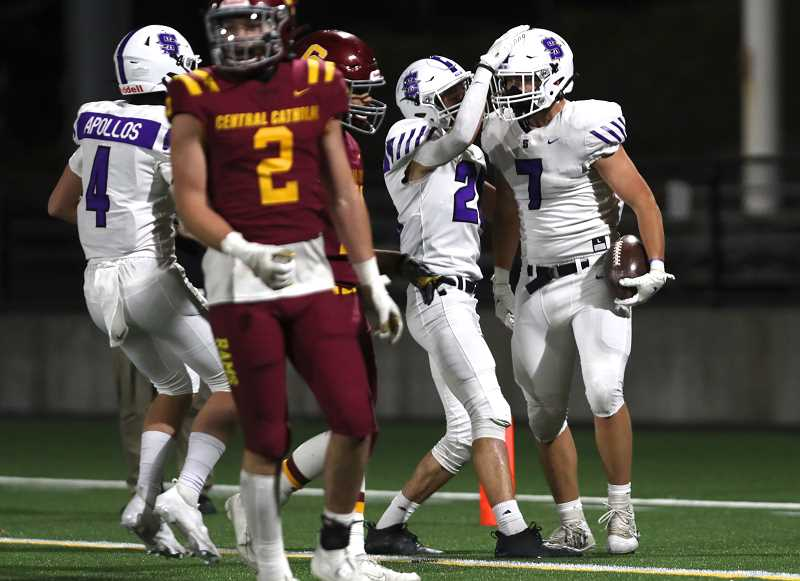 PMG PHOTO: JAIME VALDEZ - Sunset tight end Owen Stark (7) celebrates after scoring a touchdown against Central Catholic during the Apollos' 38-31 overtime win over the Rams Friday night, April 9, at Hillsboro Stadium.