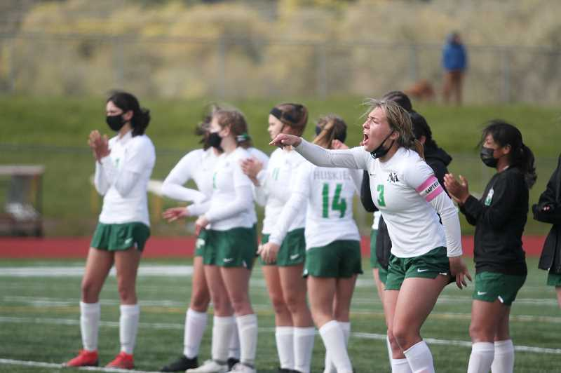 PMG PHOTO: PHIL HAWKINS - Hammack and the Huskies cheer from midfield in the midst of penalty kicks. The two teams tied at 4-4 after the first round of PKs, leading to Adrie Laders game-winning penalty kick in the seventh round of attempts.