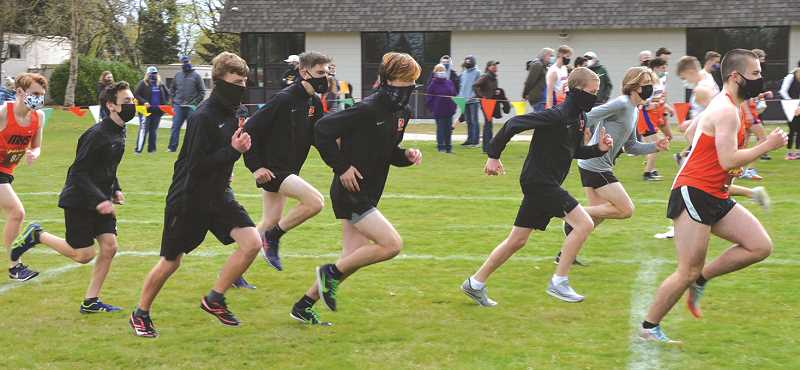 COURTESY PHOTO: MOLALLA XC - The Molalla boys cross country team warming up before the re-organized state meet April 10 at Marist High School.