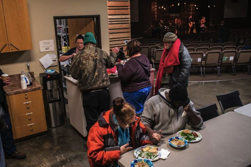 PMG FILE PHOTO - Community members gather for shelter and a meal. Photo taken pre-pandemic.