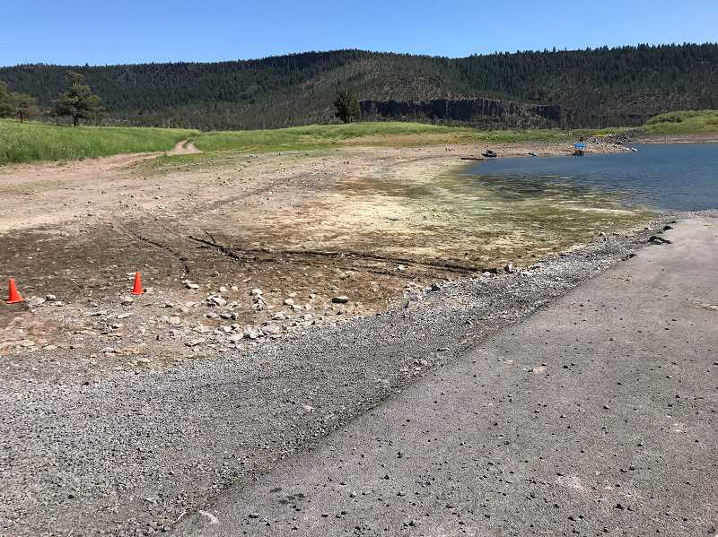 CENTRAL OREGONIAN - Ochoco Reservoir was already getting empty last summer, as the photo above shows. Due to poor snowmelt runoff, the water level is still low.