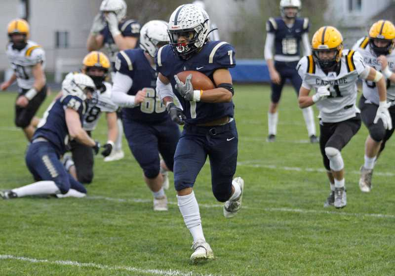 PMG PHOTO: WADE EVANSON - Banks' Jamar Flippen carries the ball during the Braves' game against Cascade this past Friday, April 9, at Banks High School.