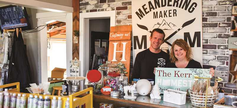 RAMONA MCCALLISTER - Jeff and Jodi Kerr surround themselves with a variety of their products, including their ready-to-glaze pottery, paint, custom stencils and kits. They are standing in front of their own custom-made sign and logo.