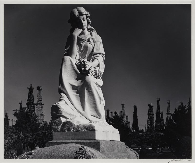 PHOTO: ANSEL ADAMS - 'Cemetery Statue and Oil Derricks, Long Beach, California, 1939' shows Adams more critical of oil exploration's effect on the environment.