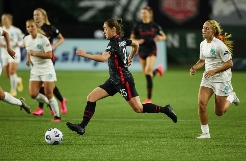 COURTESY PHOTO: CRAIG MITCHELLDYER/PORTLSND THORNS FC - Meghan Klingenbers enjoyed getting a run as a midfielder in the Portland Thorns' April 9 opener at Providence Park, a 2-1 win over Kansas City in the NWSL Challenge Cup.
