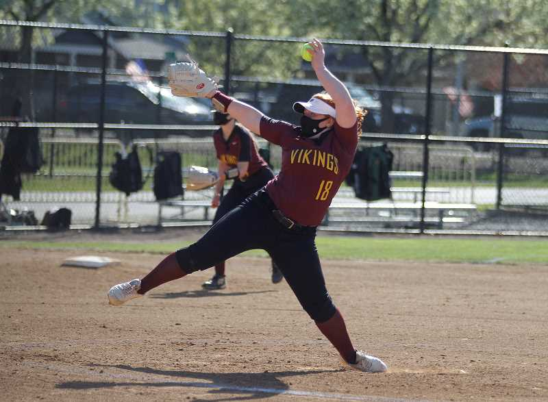PMG PHOTO: WADE EVANSON - Forest Grove pitcher Ella Taplin hurls a pitch during the Vikings' game against Liberty Tuesday, April 13, at Forest Grove High School.
