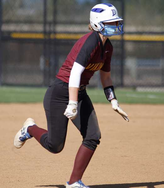 PMG PHOTO: WADE EVANSON - Forest Grove senior Carmen Sahlfeld runs for third base during the Vikings' game against Liberty Tuesday, April 13, at Forest Grove High School.