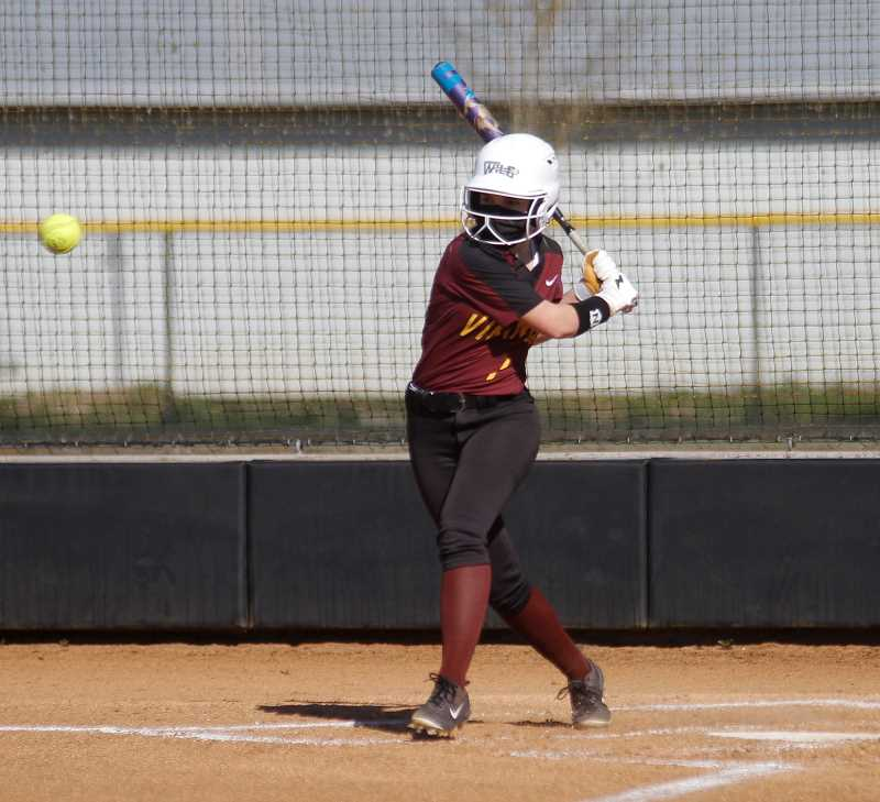 PMG PHOTO: WADE EVANSON - Forest Grove freshman outfielder Katelyn Petersen takes a cut during the Vikings' game against Liberty Tuesday, April 13, at Forest Grove High School.
