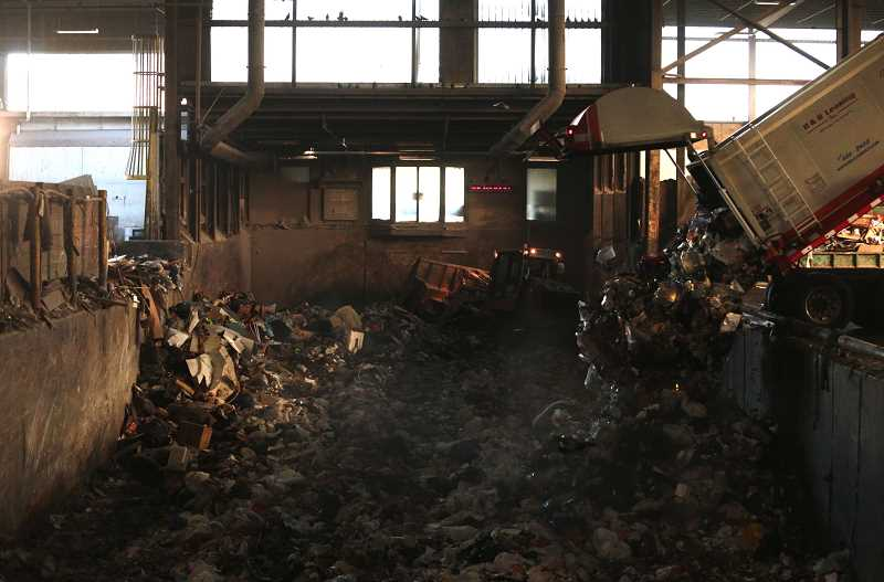 PMG FILE PHOTO - Garbage is collected and moved into a compactor at the Metro South transfer station in Oregon City.