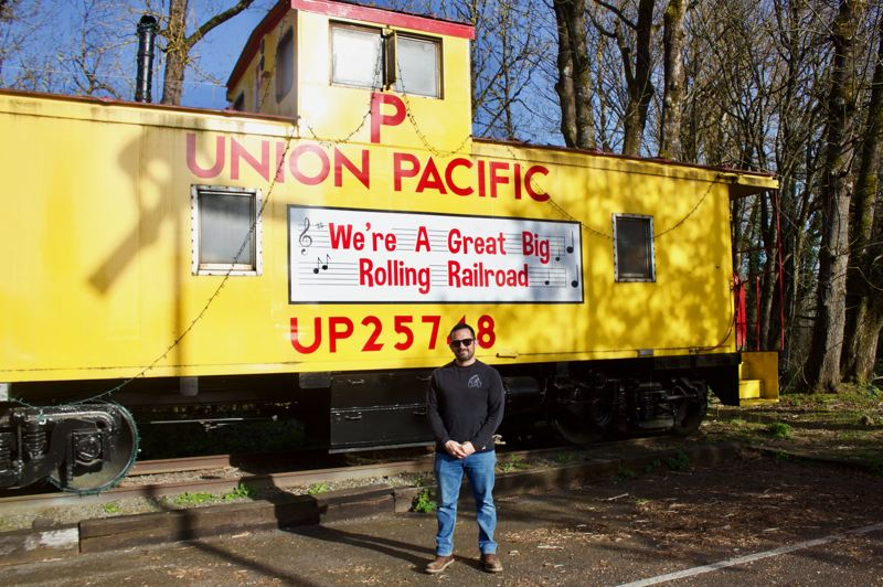 PMG PHOTO: CHRISTOPHER KEIZUR - Mayor Randy Lauer stands next to the famous Troutdale yellow caboose.