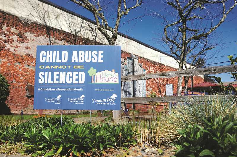 PMG PHOTO: GARY ALLEN - Brightly colored pinwheels and ribbons, along with signs, have been erected throughout Yamhill and Polk counties to draw attention to Juliette's House's efforts to stop child abuse.