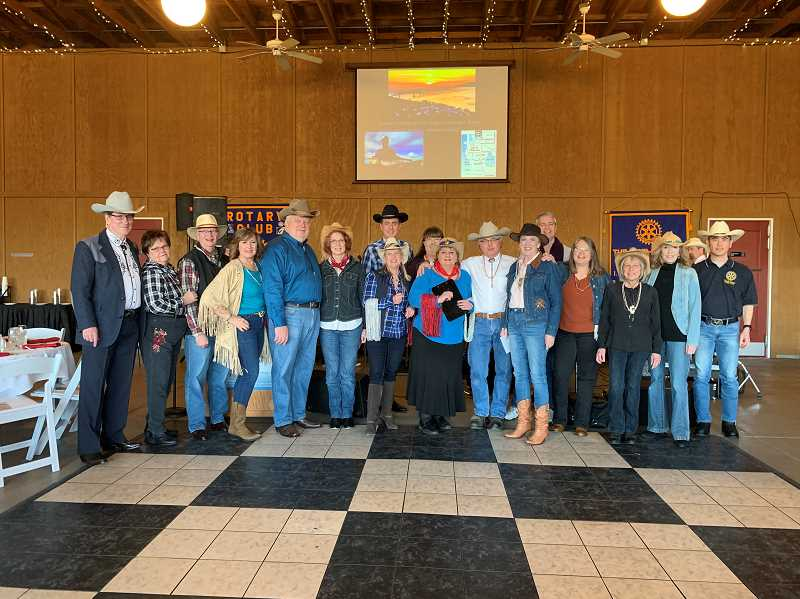 COURTESY PHOTO: RITA SEGURA  - West Linn Rotary Club members pose for a photo at the 2019 Barn Dance event.