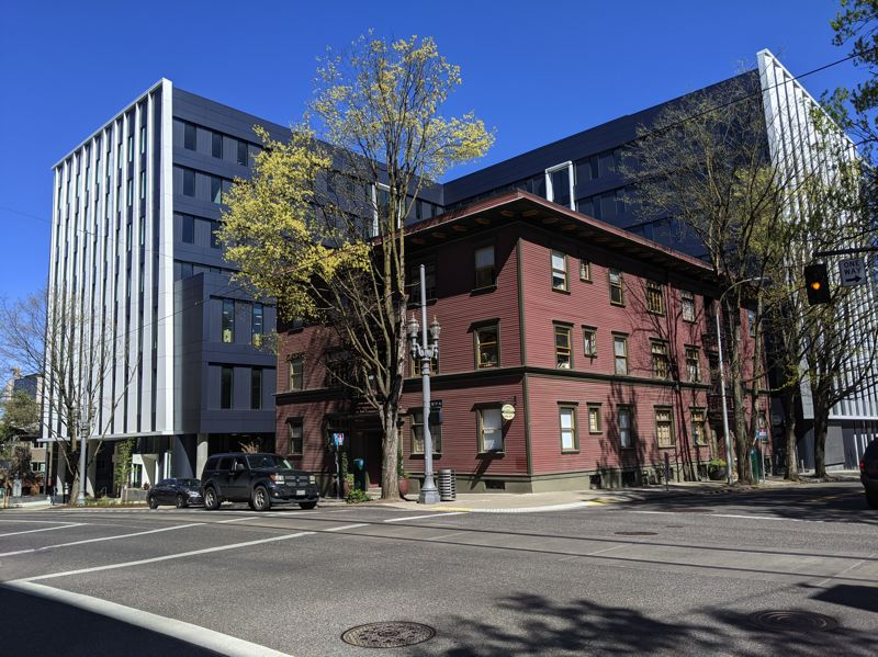 PMG: JOSEPH GALLIVAN - The Vanport Building (silver) wraps around a historic apartment building (brown) at 5th Ave and Montgomery.