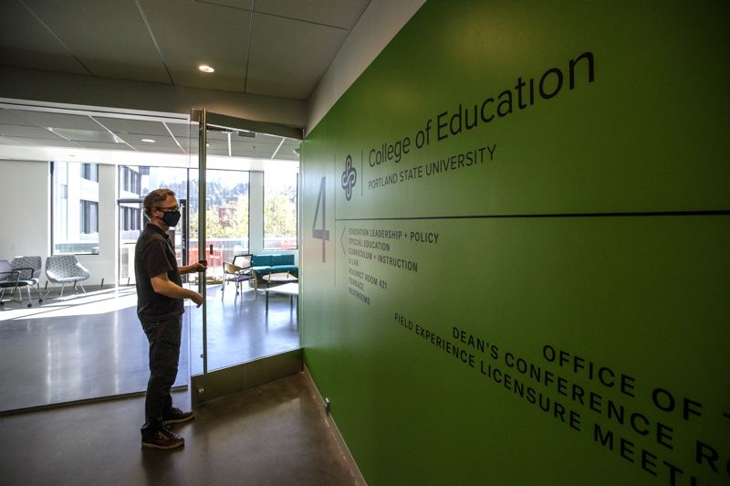 PMG PHOTO: JONATHAN HOUSE - Building manager Jason Franklin talks about PSU's new Vanport Building. The College of Education, which has now moved twice in five years, has a new home here, with a deck.