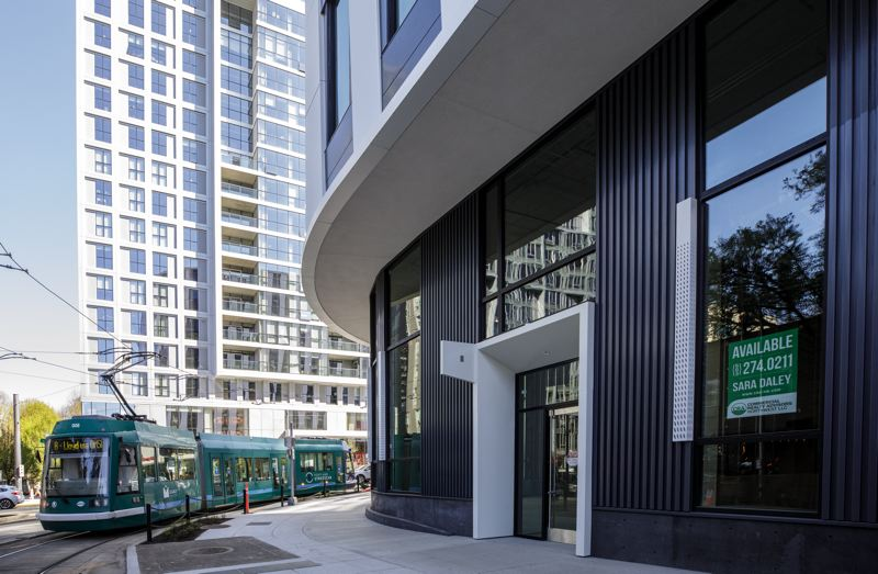 PMG PHOTO: JONATHAN HOUSE - The new Vanport Building, shared by PSU, PCC, OHSU, and the City of Portland, is quietly open downtown. SRG Partnership designed the curves to reflect the reality of having the Streetcar turning around the building. The ground floor retail is PSU's responsibility. The college hopes to get a coffee shop in this space by 2022.