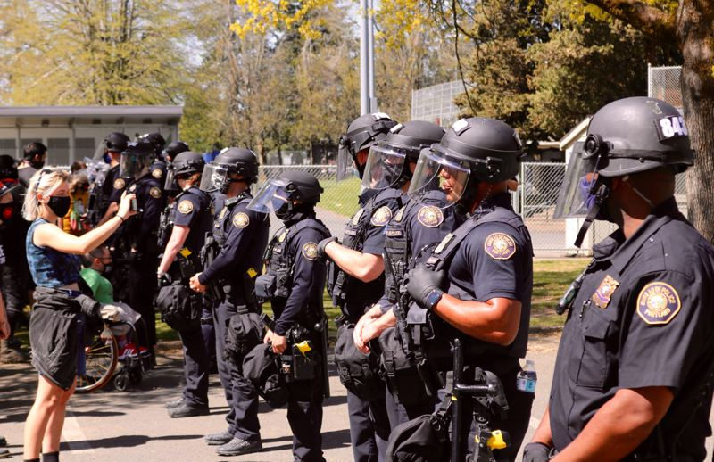 PMG PHOTO: ZANE SPARLING - Portland Police Bureau officers and protesters faced off at Lents Park on Friday, April 16, following a fatal police shooting.