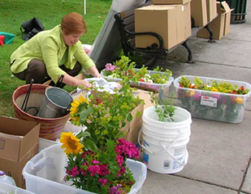 COURTESY PHOTO - Workers prepare for the 'Main Course' dinner held on Main Street in downtown Forest Grove between 2003 and 2012. The Forest Grove Chamber of Commerce is trying to resurrect the event as an annual  'Farm to Table' celebration.