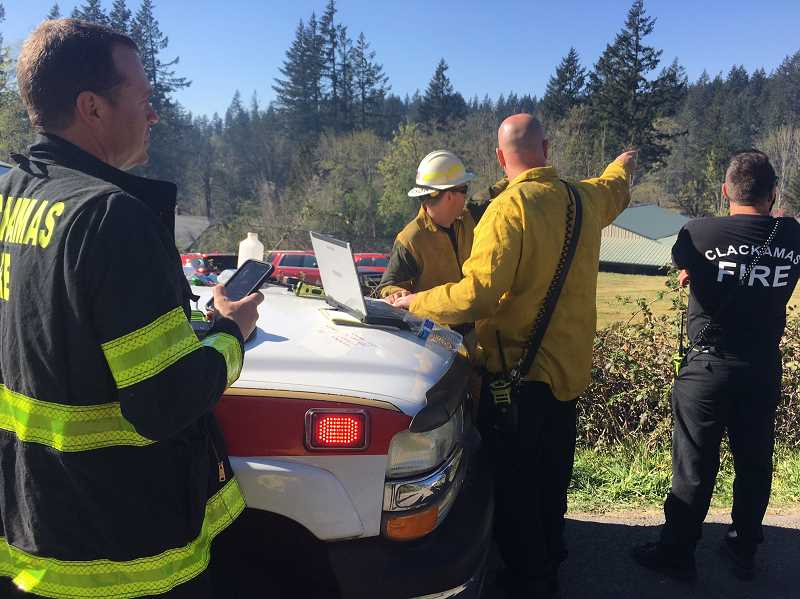 COURTESY PHOTO: CLACKAMAS FIRE - Clackamas Fire incident commanders plan a course of tackling the April wildfire near Oregon City.