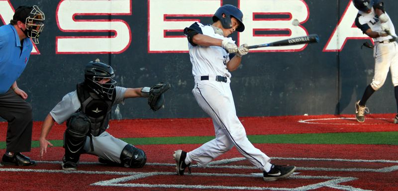 PMG PHOTO: MILES VANCE - Lake Oswego junior Andrew Wong hits a fifth-inning RBI single during his team's 2-0 win over Mountainside at Lake Oswego on Friday, April 16.