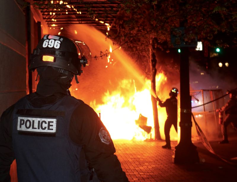 Fire and gunshots: Portland police declare downtown riot
