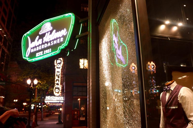 PMG PHOTO: ZANE SPARLING - A window was smashed at John Helmer Haberdasher on Friday, April 16.