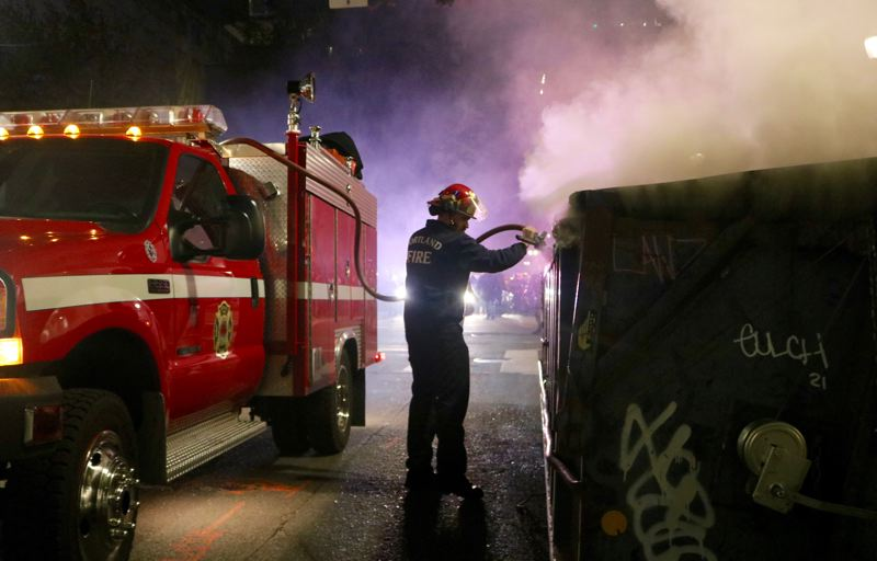 PMG PHOTO: ZANE SPARLING - Portland Fire & Rescue crews extinguished a separate dumpster fire in downtown Portland on Friday.