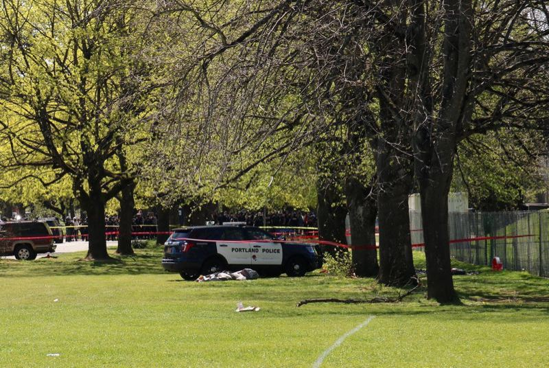 PMG PHOTO: ZANE SPARLING - A covering was laid over Douglas Delgado after he was fatally shot by police Friday, April 16, in Lents Park.