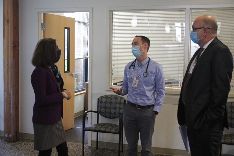 PMG PHOTO: PHIL HAWKINS - Brown was led on an hourlong tour of Salud Medical Center in Woodburn by Program Director Dr. Antonio Germann (middle) and Yakima Valley Farm Workers Clinic Chief Medical Officer Kevin Heidrick.