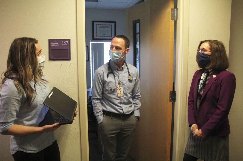 PMG PHOTO: PHIL HAWKINS - Brown meets with a medical student from Pacific University (left) during a tour of the Salud Medical Center in Woodburn led by Dr. Antonio Germann.