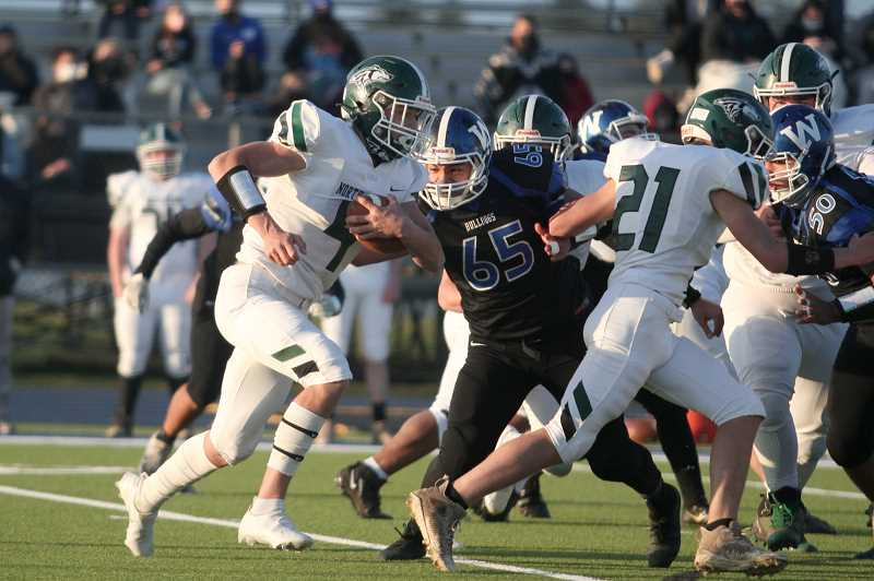 PMG PHOTO: PHIL HAWKINS - Lineman Santiago Roque Manzo (65) garnered First Team honors on offense and Second Team honors on defense. Teammate Liua Falepapalangi (50) was also a First Team all-offense selection.