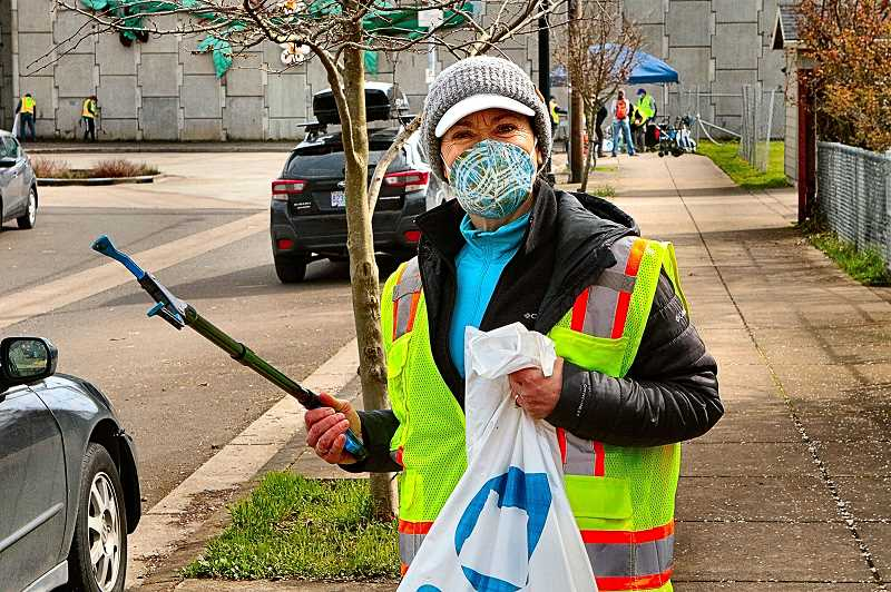 DAVID F. ASHTON - With picker and trash bag in hand, monthly path clean-up organizer Catherine Schroeder - an Eastmoreland resident - was set to start de-trashing the I-205 Multi-Use Path.
