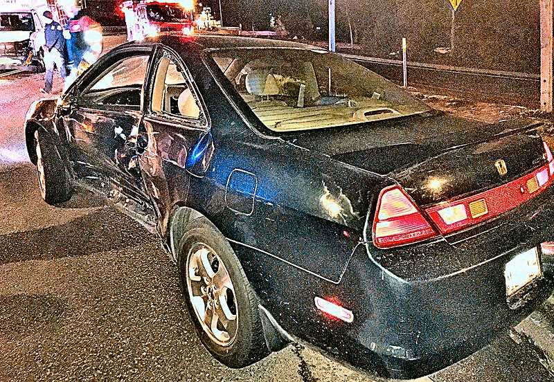 COURTESY PORTLAND POLICE BUREAU - This 1999 Honda Accord was stolen from its driver by an armed robber in Mt. Scott-Arleta, but the bandit ended up crashing the car into a TriMet minibus in North Portland not long afterward, and then running off into the predawn darkness.
