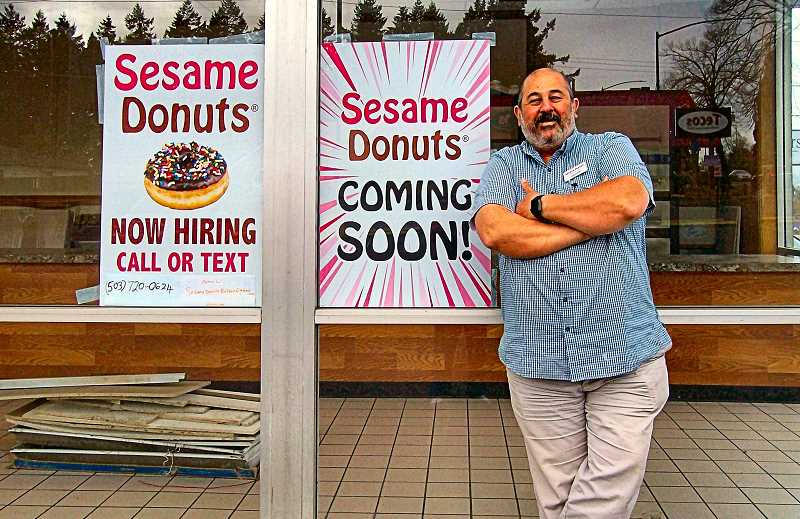 RITA A. LEONARD - Co-owner (with his brother) Haidar Fakih stands at the entrance to the new Sesame Donuts location in Southeast Portland - open 5 a.m. till 8 p.m. seven days a week, at S.E. 41st and Powell Boulevard.