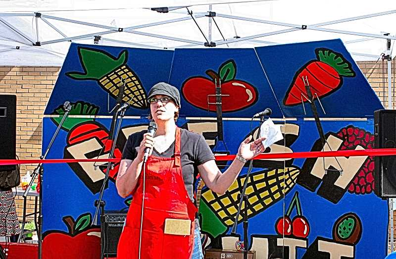 COURTESY OF WOODSTOCK FARMERS MARKET - Emily Murnen, the outgoing Market Manager, is shown in a photo taken ten years ago on the very first day of the Woodstock Farmers Market, back in in June of 2011.