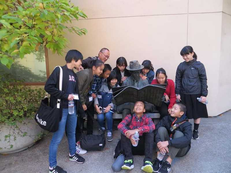 COURTESY PHOTO: FOREST GROVE SISTER CITIES COMMITTEE - Young people from Nyuzen, Japan, pose with a statue during a visit to Forest Grove in 2017.