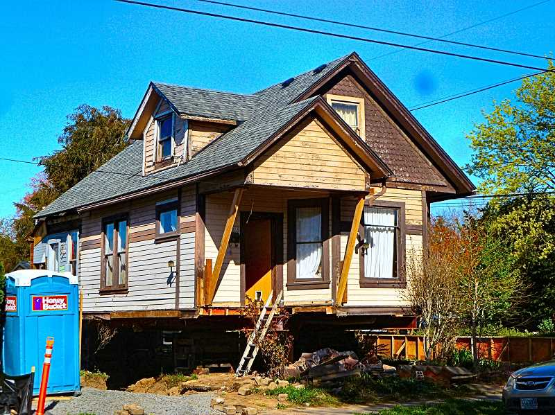 EILEEN G. FITZSIMONS - Levitating above its old foundation, this 1903 home at S.E. 11th Avenue at Bidwell Street will soon have a new apartment plus a tiny house to offer three different sets of long-term affordable renters.