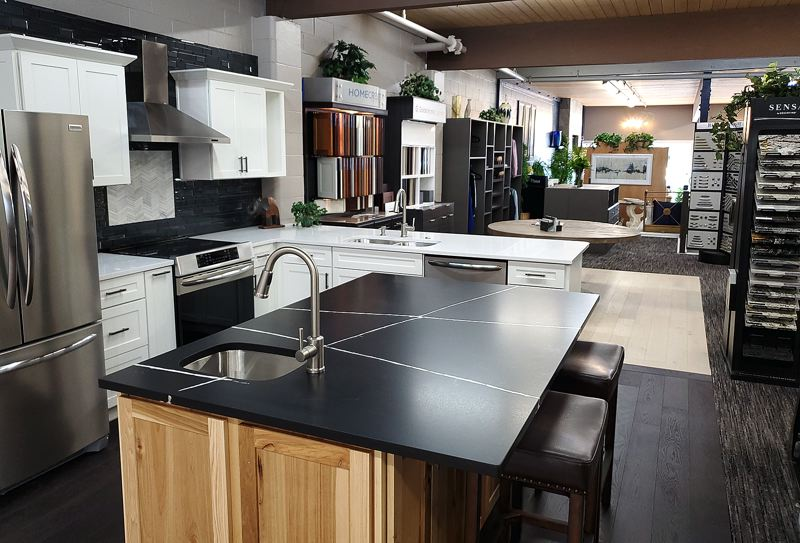 METRO CREATIVE SERVICES - Custom NW Remodelings showroom highlights its quality products in real-life settings, with full-kitchen displays featuring Hamiltons Appliances.